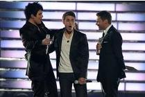 Kris Allen, center, reacting after Ryan Seacrest, right, announces that he was the winner